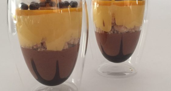 Chocolate and exotic fruits in a glass